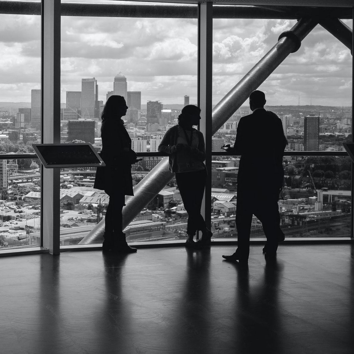 people standing inside city building